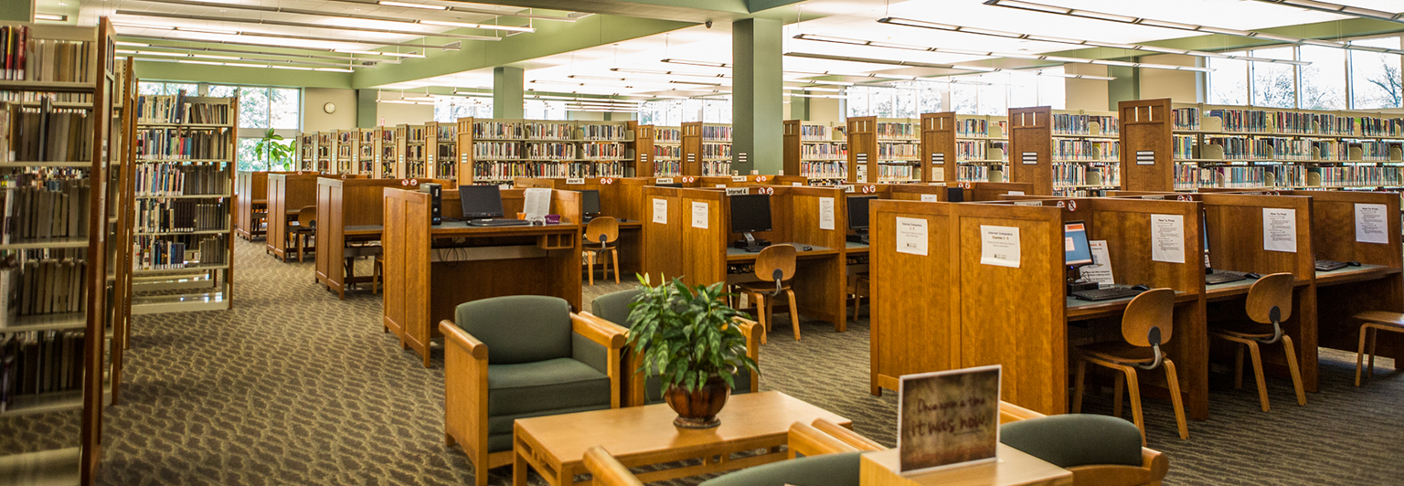 Interior shot of the library showing bookstacks and seating