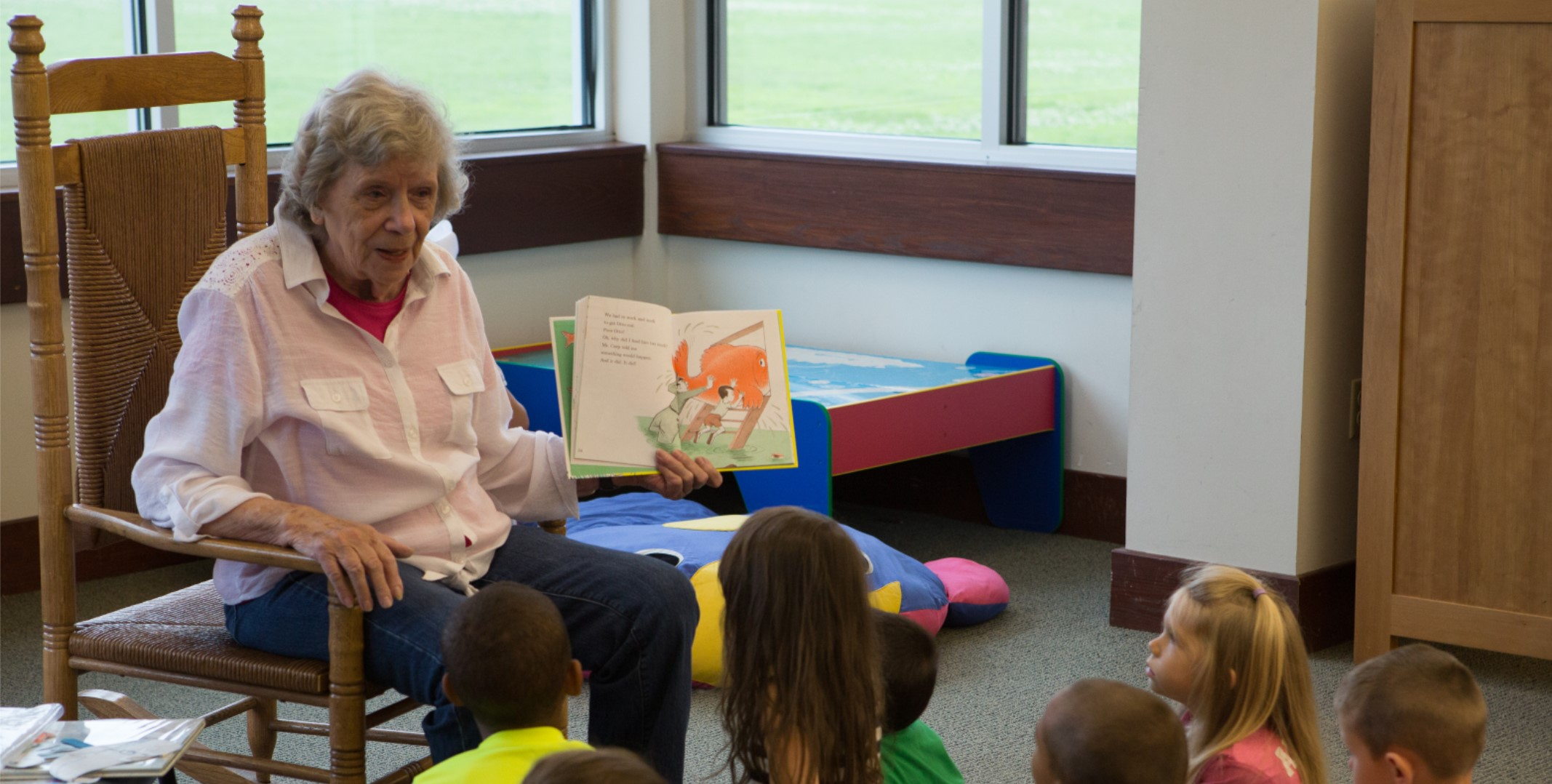 Woman reading to children during storytime at Windsor Drive Branch
