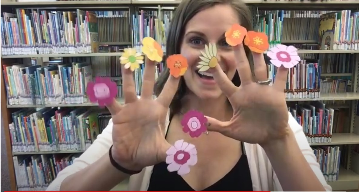 Mrs. Tiffany with flower puppets on her fingers