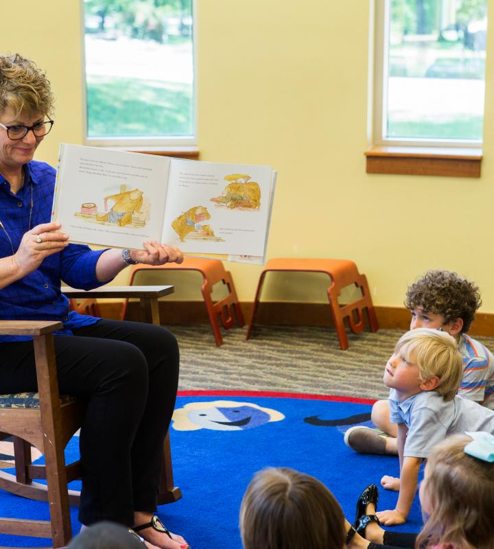 Woman reading to children during storytime