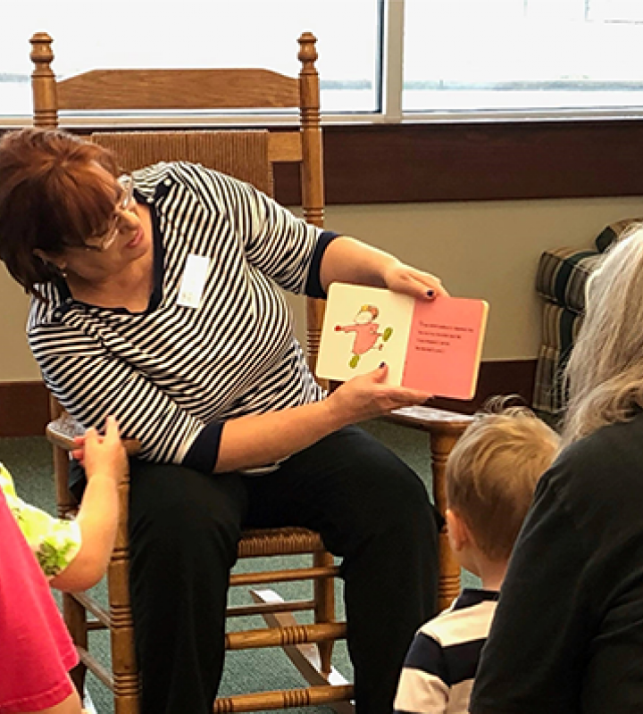 Librarian reading to children during storytime at Dallas Street Branch